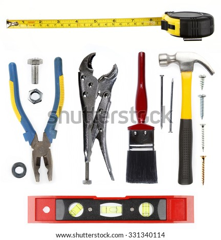 Assorted tools on plain background