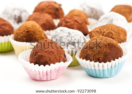 Assorted truffles on white background