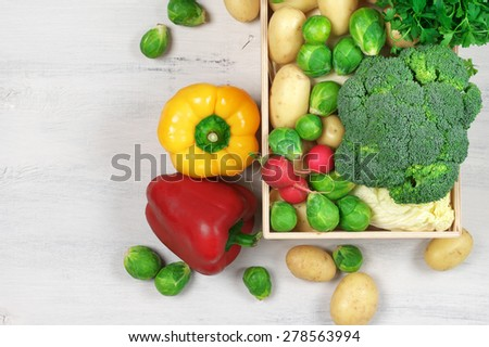 Assorted vegetables in wood box on rustic wooden background. Top view point. - stock photo