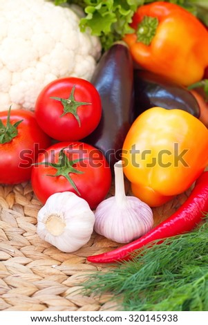 Assorted vegetables on the wooden table