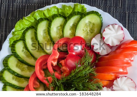 Assorted vegetables. radish, tomatoes, cucumbers, peppers - stock photo