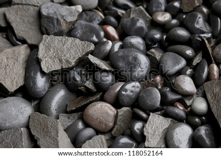 Assorted wet round and angular pebbles