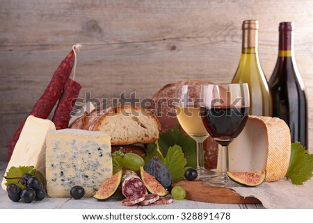 assorted wine,bread and cheese - stock photo