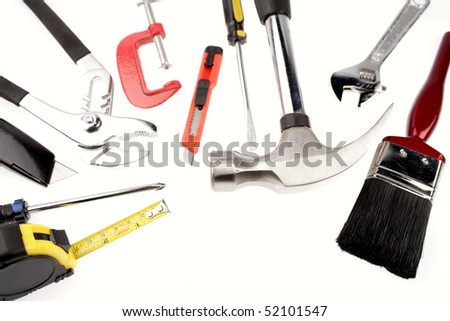 Assorted work tools on white