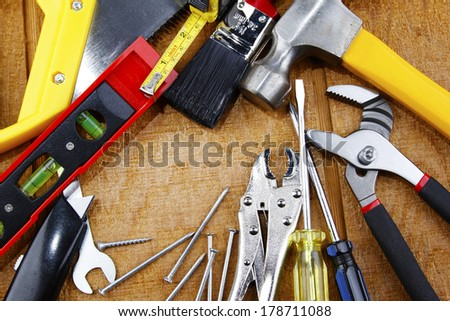 Assorted work tools on wood
