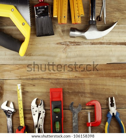 Assorted work tools on wood. Directly above view. Copy space - stock photo