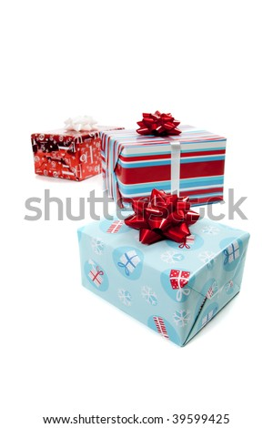 Assorted wrapped Christmas presents on a white background with copy space