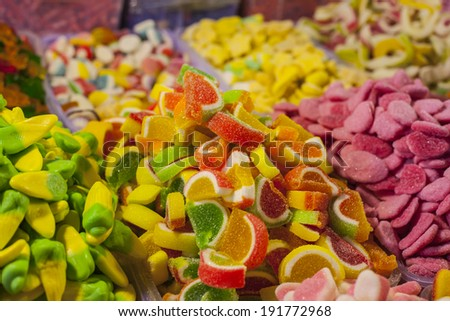 assortment colorful gummy candies at market  - stock photo