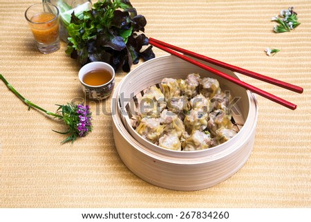 assortment dimsum / Chinese Steamed shrimp dumplings dimsum in bamboo containers traditional cuisine. - stock photo