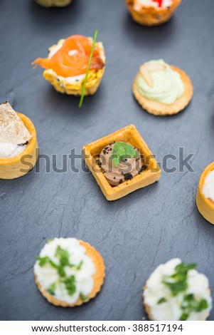 Assortment festive appetizers with tapas, finger food - stock photo