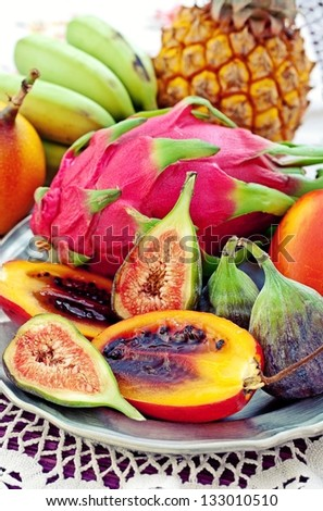 assortment of a fresh exotic fruits on a table. - stock photo