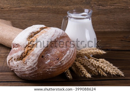 Assortment of baked bread on wooden table background