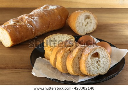 Assortment of baked bread on wooden table background , Bread used to make textures.
