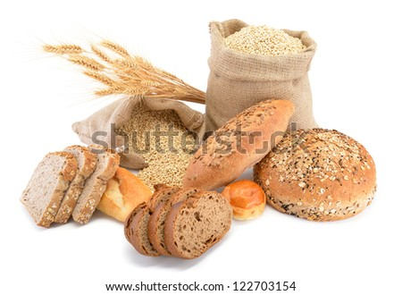 Assortment of baked bread over wheat sack isolated on white background - stock photo