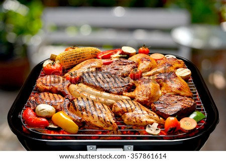 Assortment of barbecue on the grill on outdoor background - stock photo