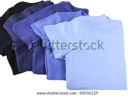 Assortment of blue t-shirts - stock photo