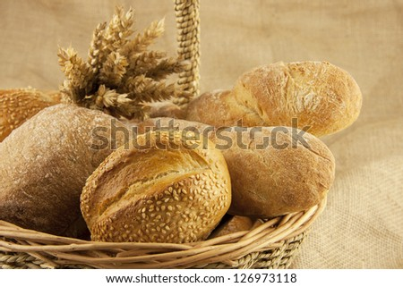 assortment of bread and pastries in a basket