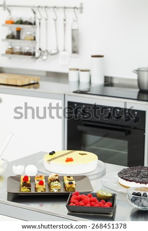 Assortment of cakes in kitchen - stock photo