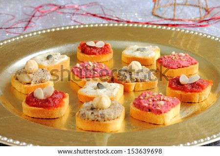 Assortment of canapes with Christmas decoration - stock photo