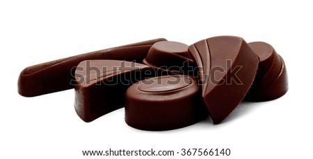 Assortment of chocolate candies isolated on a white background - stock photo