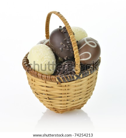 assortment of chocolate eggs in a basket - stock photo