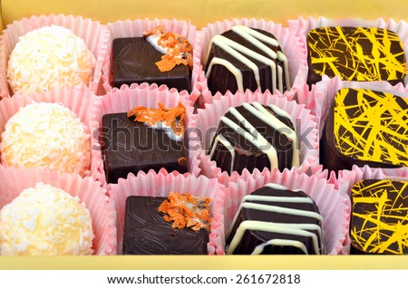 assortment of chocolate sweets on the bamboo mat - stock photo