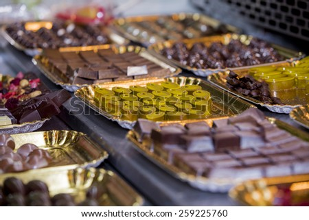 Assortment of chocolates in the shop window - stock photo