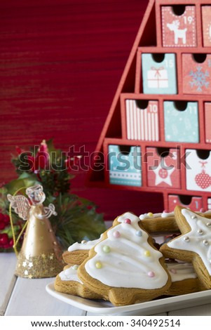 Assortment of Christmas Cookies with Bowls of Sugar Pearls on Decorated Table - stock photo