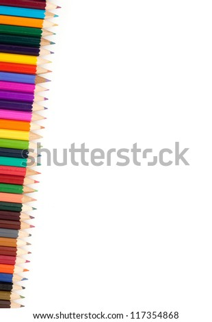 Assortment of color pencils with shadow on white background
