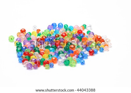 Assortment of colorful beads on white