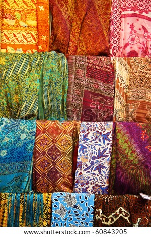 Assortment of colorful sarongs for sale - stock photo