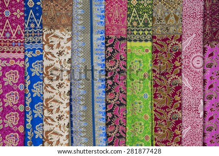 Assortment of colorful sarongs for sale, Island Bali, Ubud, Indonesia. Close up - stock photo