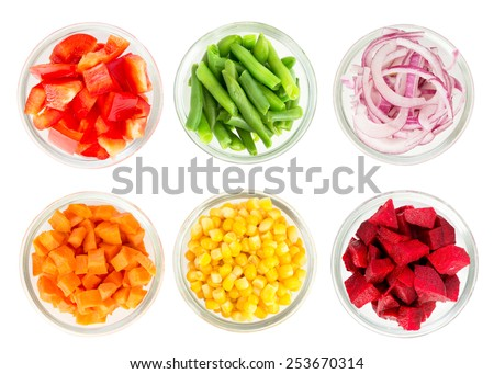 Assortment of cut vegetables in glass bowls isolated on white background. Top view. - stock photo
