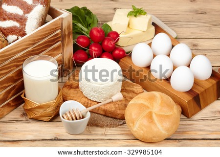 assortment of dairy products (milk, cheese, sour cream,) - stock photo