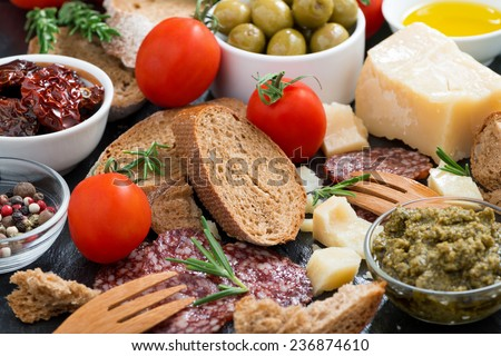 assortment of delicious antipasti, close-up, horizontal - stock photo