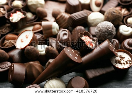 Assortment of delicious chocolate candies background, close up - stock photo
