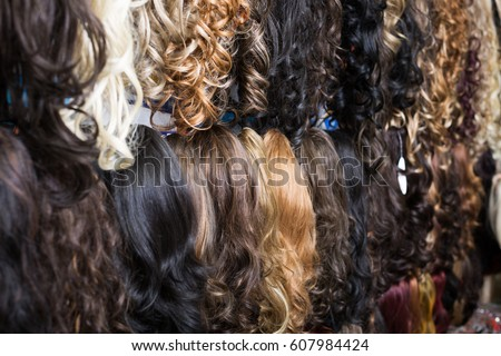 Hair extensions stock images royalty free images vectors assortment of different color long human hair extensions in salon pmusecretfo Choice Image