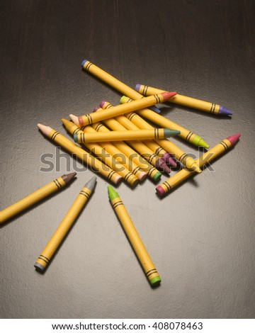 Assortment of drawing tools/Colored Crayons/Various artist pigments on a simple surface