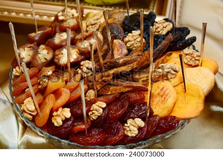 Assortment of dried fruits - stock photo