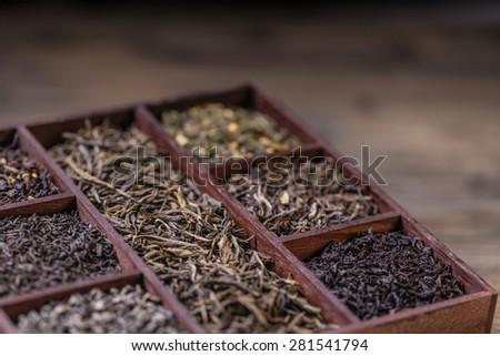 Assortment of dry tea in crate - stock photo