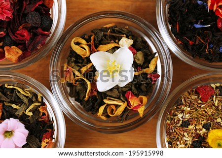 Assortment of dry tea on wooden table, close up - stock photo