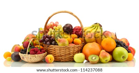 Assortment of exotic fruits and berries in baskets isolated on white