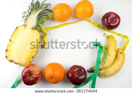 Assortment of Exotic Fruits and Measuring Tape Isolated.