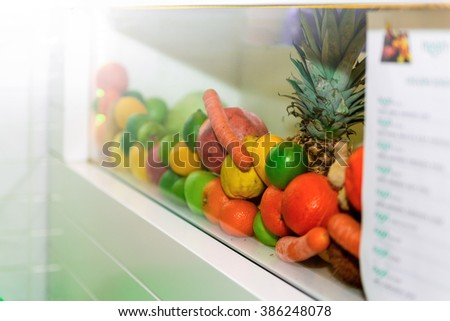 Assortment of Exotic Fruits Close-Up, Juicy Fruits Background. Heap of Fresh Fruits and Vegetables Exposed in White Glass Shelf, Ready for Squeezing Fresh Juice in a Caf�©. - stock photo