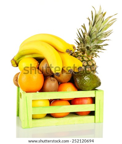 Assortment of exotic fruits in box isolated on white - stock photo
