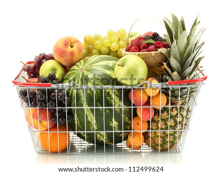 Assortment of exotic fruits in metal basket isolated on white - stock photo