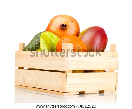 Assortment of exotic fruits in wooden box isolated on white