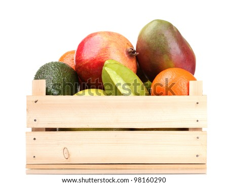 Assortment of exotic fruits in wooden box isolated on white - stock photo
