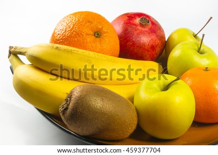 Assortment of exotic fruits on white background