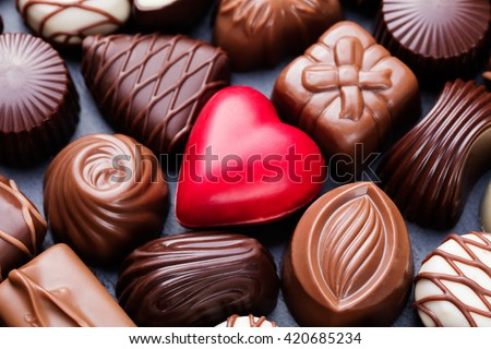 Assortment of fine chocolate candies, white, dark, and milk chocolate Sweets background Copy space Top view - stock photo